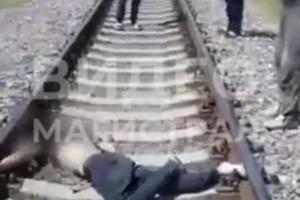 Андижонда қулоқчин тақиб кетаётган йигитни поезд босиб кетди